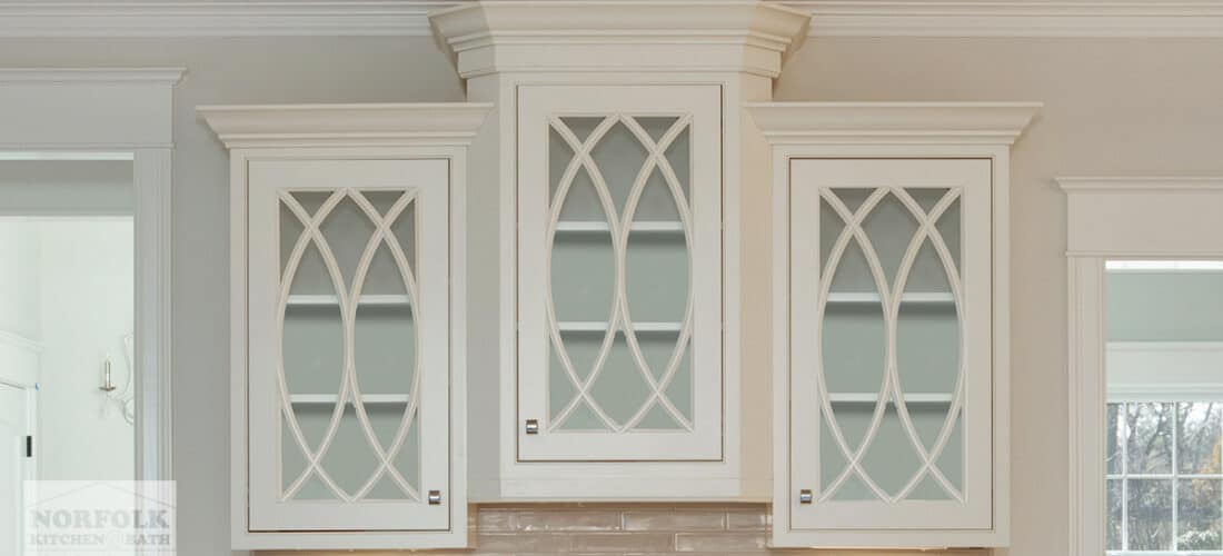 3 white wall kitchen cabinets with gothic glass mullion doors