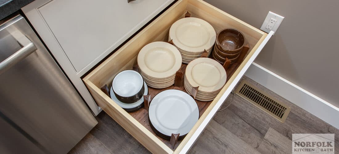 a large kitchen cabinet drawer with a plate organizer upgrade
