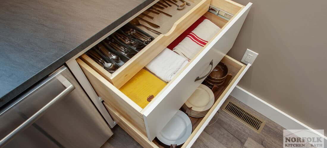 kitchen cabinets with a double drawer and a plate organizer upgrade