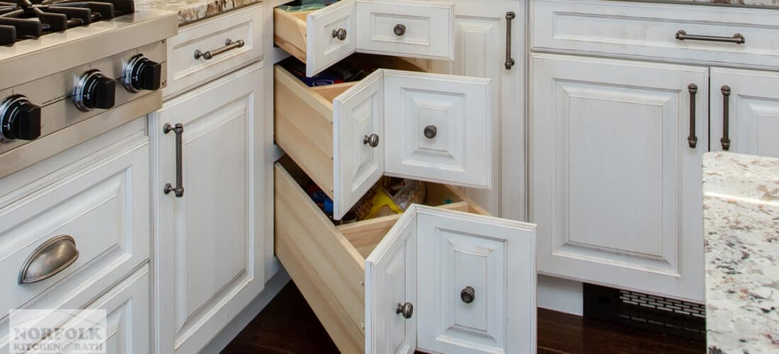 white kitchen cabinets with a corner drawer cabinet upgrade