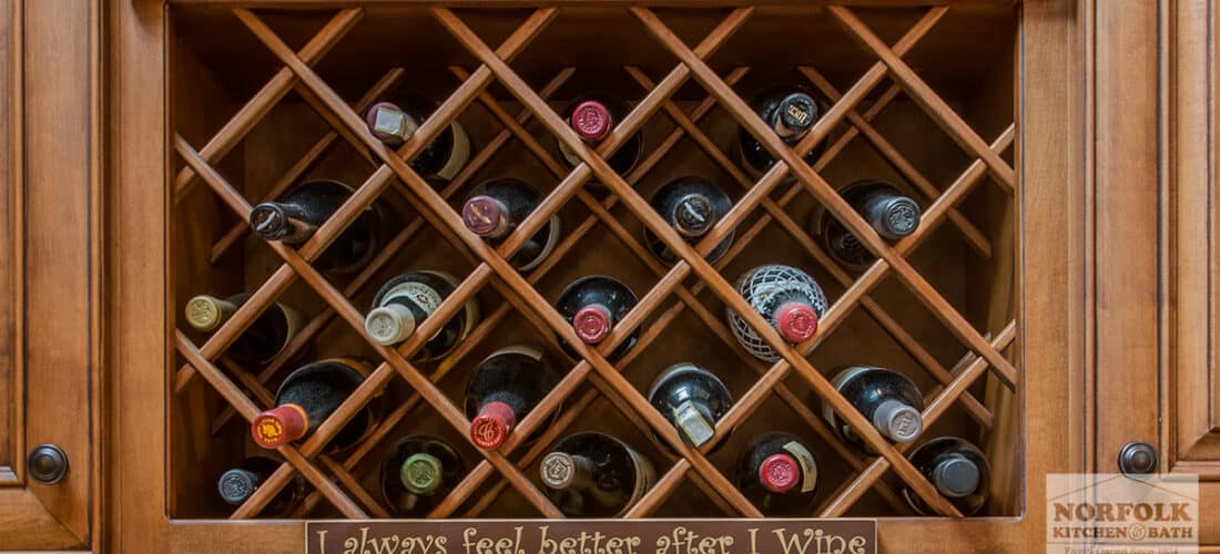 a medium size wine rack filled with wine bottles