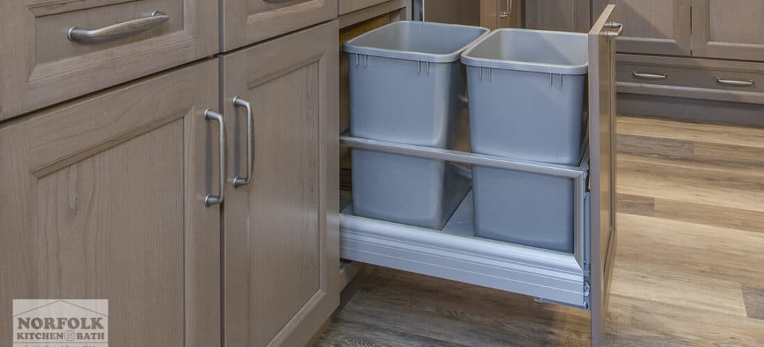 Stained kitchen cabinets with a pull-out trash upgrade