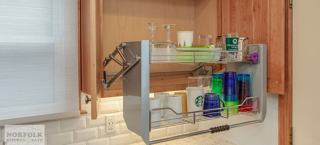 an ADA cherry kitchen cabinet with a special pull down upgrade to make the shelving more accessible for a handicapped individual