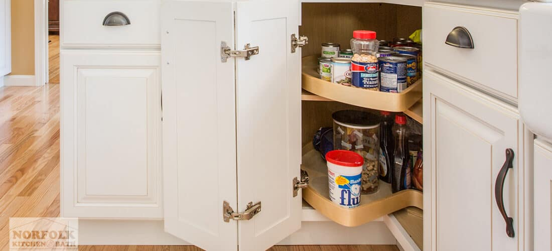 white kitchen cabinet with a lazy susan inside