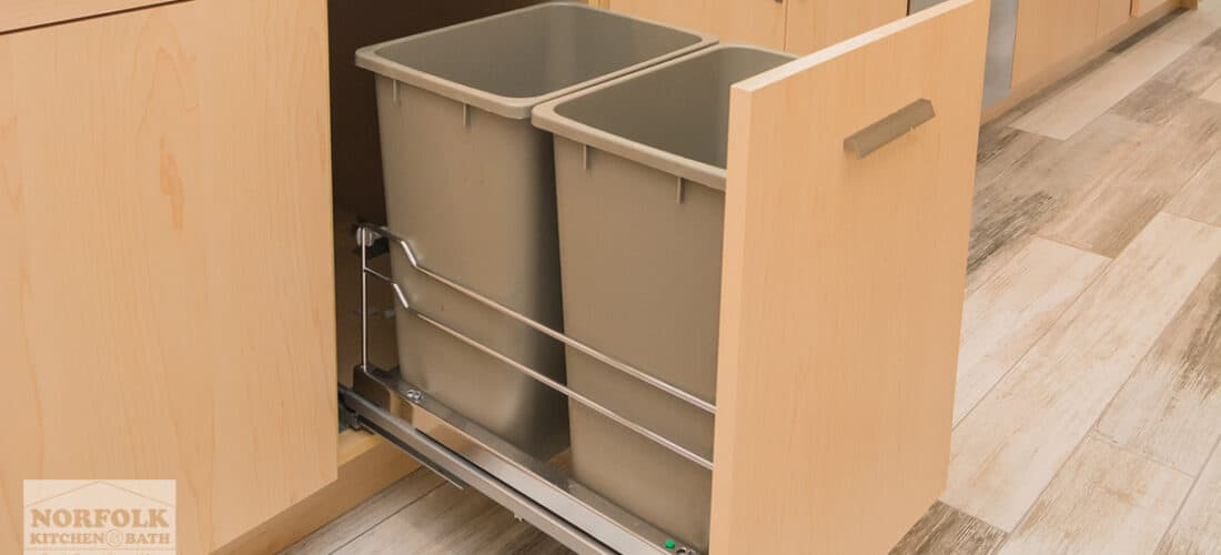 a base kitchen cabinet in a natural finish with a trash pull-out upgrade