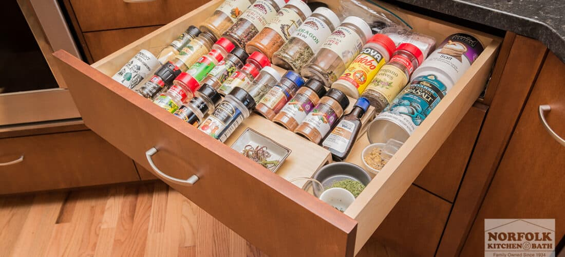 a kitchen cabinet drawer with a spice storage upgrade
