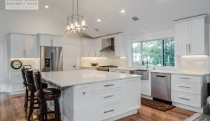 Transitional White Shaker Kitchen With Large Island