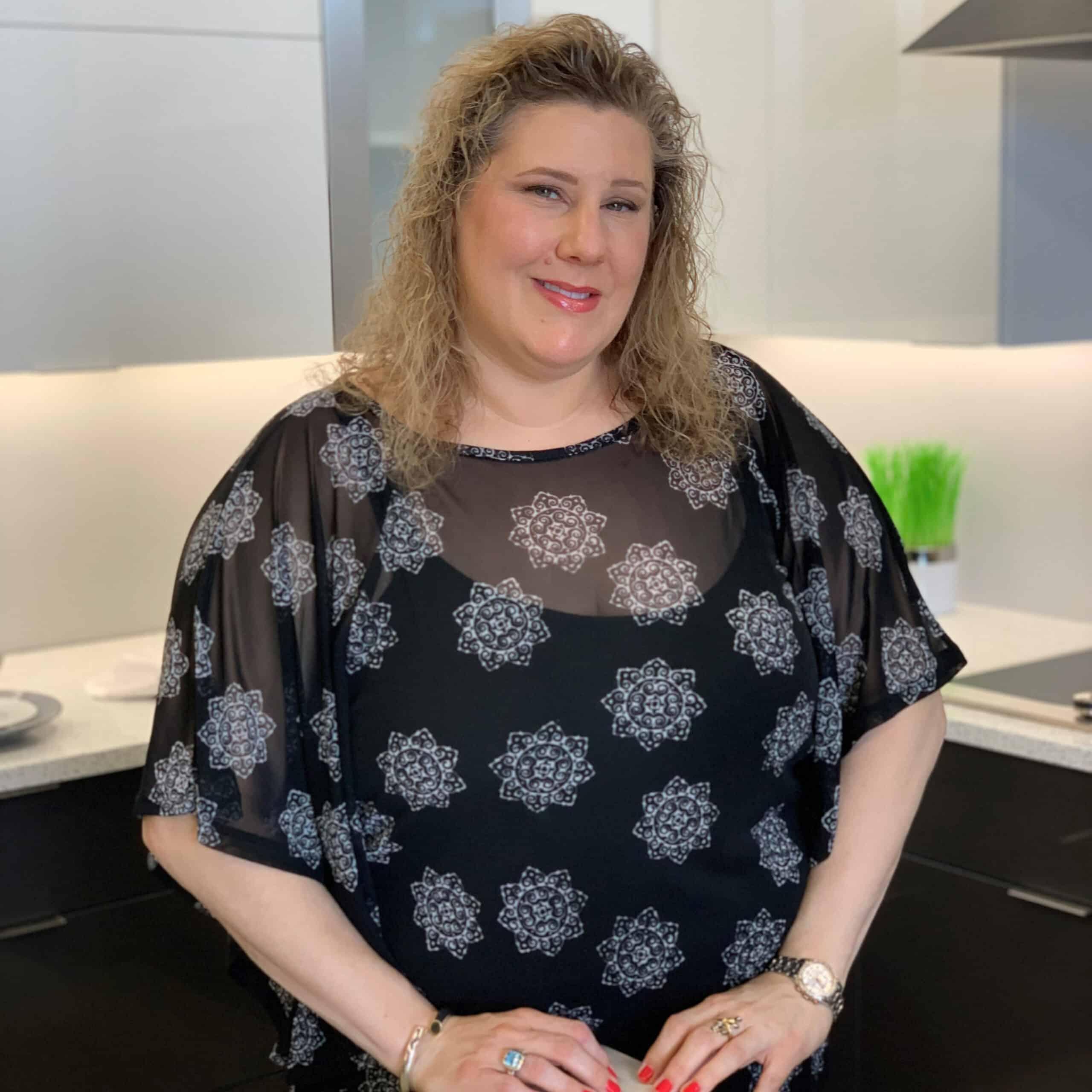Christine Maggio, a Norfolk Kitchen & Bath designer in the Salem, NH showroom