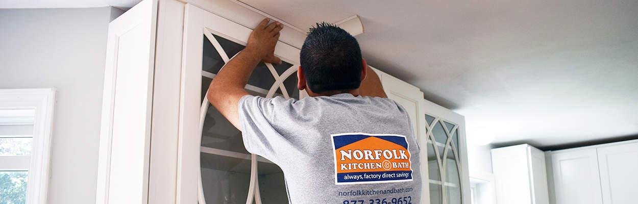 Norfolk Kitchen remodeler installing crown molding on kitchen cabinets