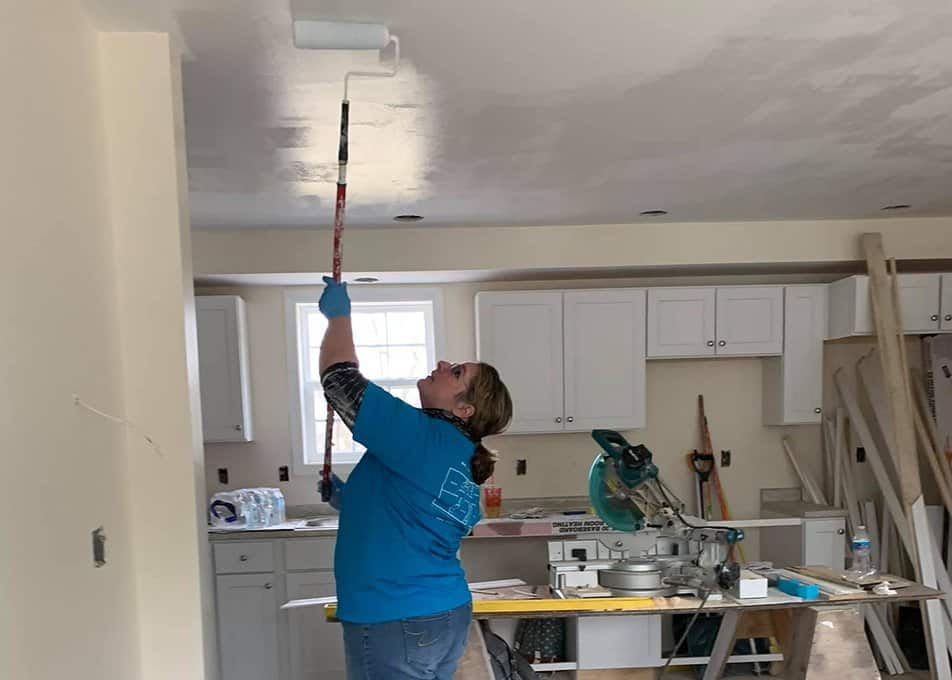 A Norfolk Kitchen & Bath employee volunteering at a Habitat for Humanity project in Easton, MA