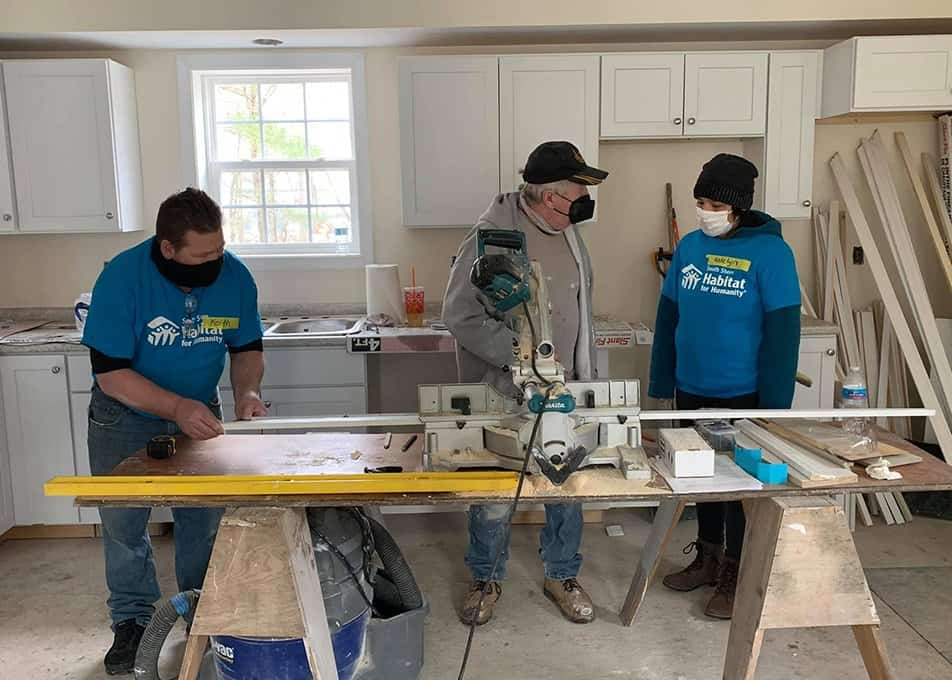 Norfolk Kitchen & Bath volunteers helping finish the kitchen in a Habitat for Humanity project in Easton, MA