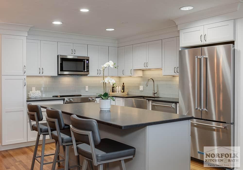 white kitchen remodel with dark countertops in a Quincy, MA condo